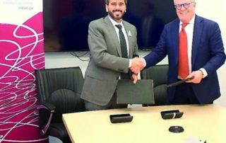 Ali Al Khalifa, CEO of Astad (left) shakes hands with Finlay Cumming, CEO of Cumming after the signing ceremony.