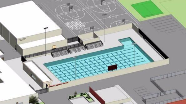 Newport-Mesa Unified School District trustees advised staff Tuesday to find additional funding for Estancia High School's planned aquatic center, depicted in this rendering, despite its higher-than-anticipated cost. (Courtesy of Newport-Mesa Unified School District)